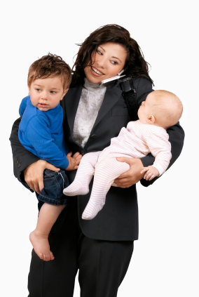 working mom holding kids