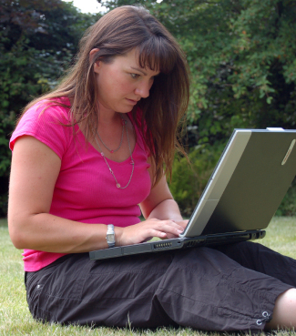 Woman outdoor with laptop