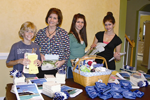 Suzanne Meyer and her kids preparing gift boxes for The Welcome Committee