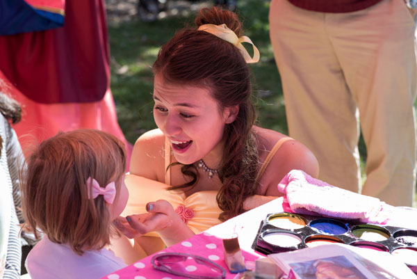Face painting with the character Belle